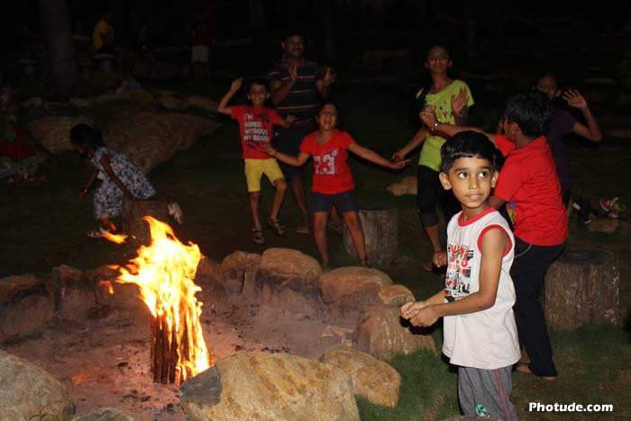 Children having fun in front of camp fire
